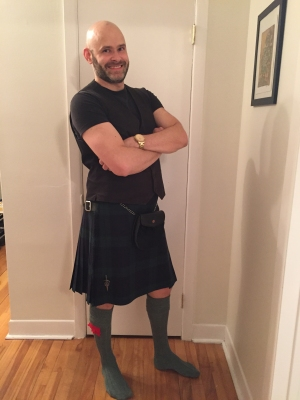 Jade Sambrook preparing to attend Bareoke in a kilt.