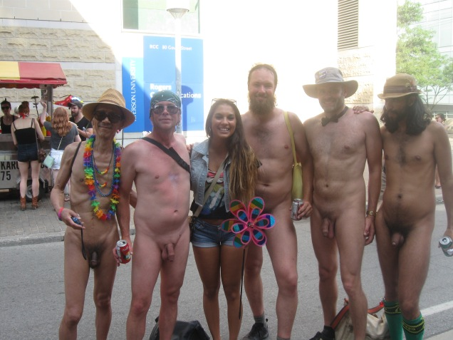 Five naked men at the Toronto Pride Parade, including Jade Sambrook, pose with a woman who requested a photo