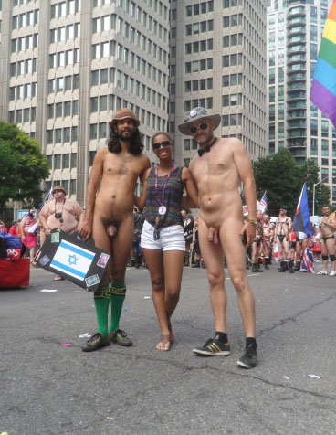 Jade Sambrook and a friend posing naked with a woman who requested a photo at the 2014 Toronto Pride Parade