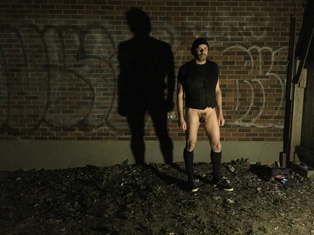 Photo of Jade Sambrook without his kilt in a trashy dark back alley from the Trashy Dark Naked Alley Photo Series.