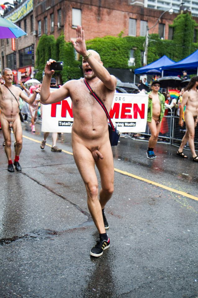 Jade Sambrook filming naked and greeting the crowd along the route of the 2015 Toronto Pride Parade.