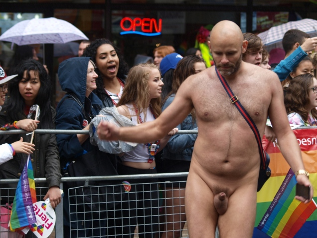 Jade Sambrook dancing naked in front of a crowd of onlookers gathered along the route of the 2015 Toronto Pride Parade.
