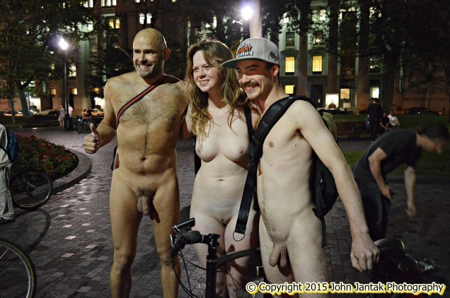 Jade Sambrook naked on rollerblades with a naked couple at the 2015 nighttime edition of the WNBR in Montreal. Photo: John Jantak/Flickr