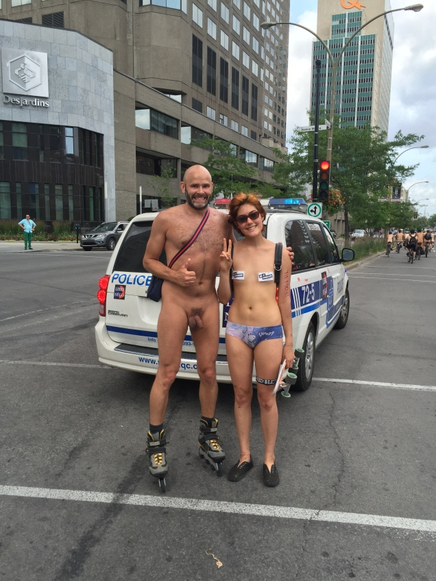 Jade Sambrook naked on rollerblades with a female skateboarder at the 2015 daytime edition of the World Naked Bike Ride in Montreal.