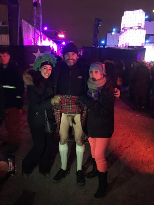 Two women hold Jade Sambrook's kilt up for a photo