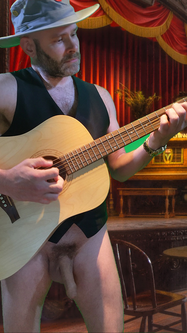 Photo of Jade Sambrook on the Naked Jade Blog playing guitar bottomless
