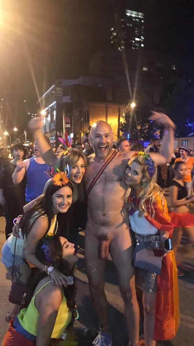 Photo of Jade Sambrook naked and surrounded by multiple women at the 2017 Pride event in Toronto