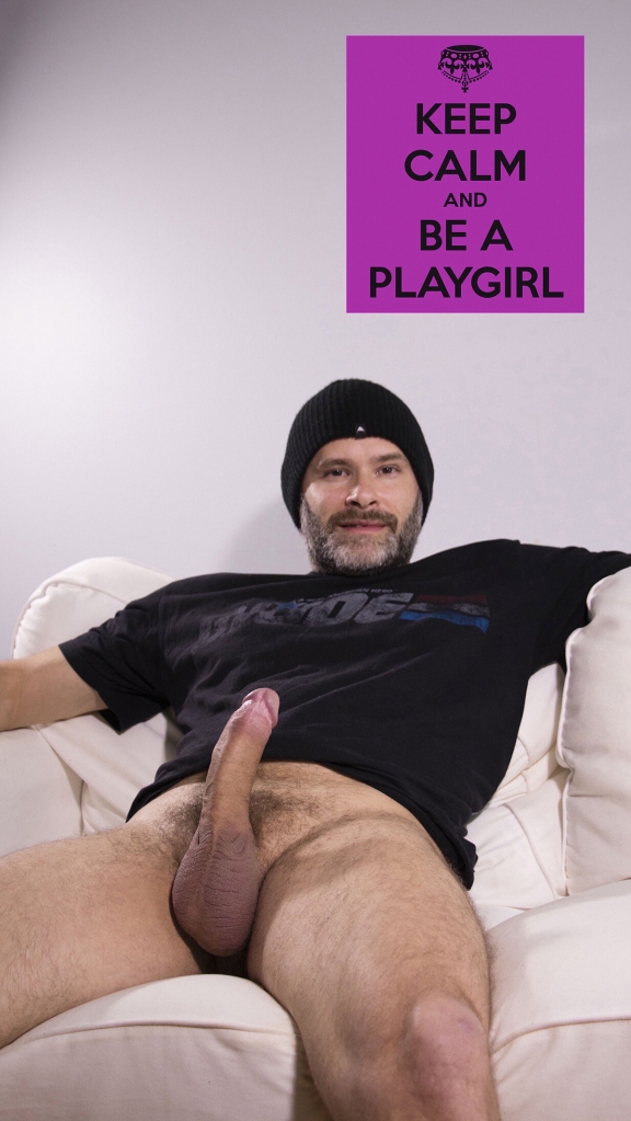 Playgirl style photo of Jade Sambrook posing nude (bottomless) with his erect penis showing