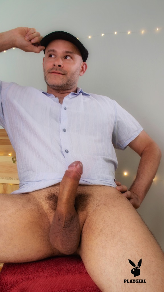 Jade Sambrook sitting on a chair with his shirt fully buttoned and his erect penis fully exposed for all to see