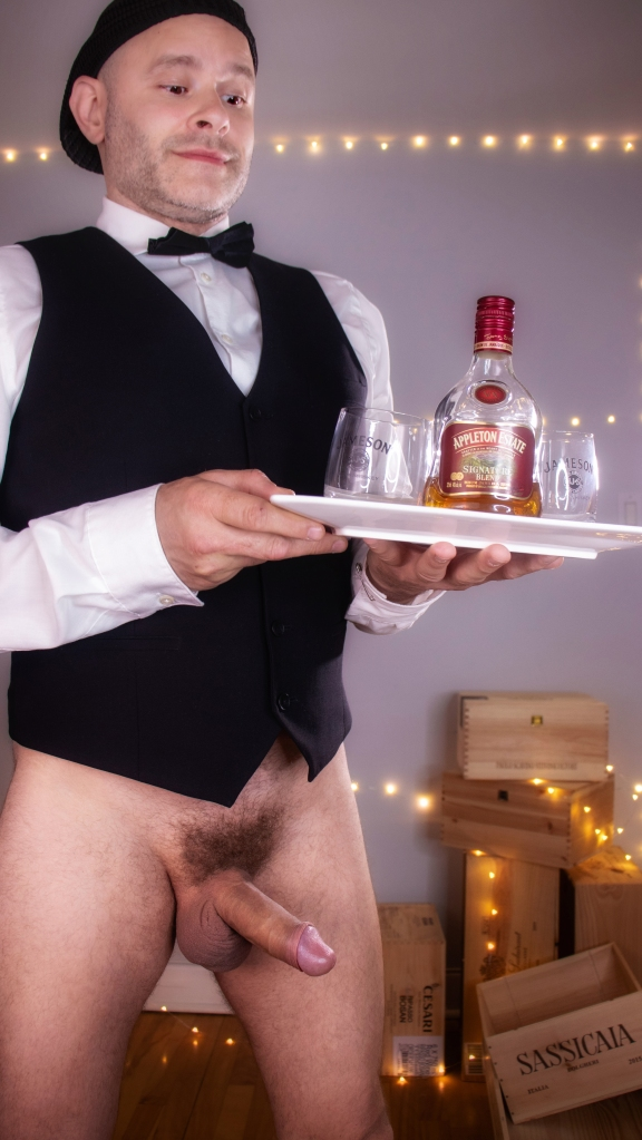 A photo of Jade Sambrook with his semi-erect penis on display while working as a Bottomless Waiter.